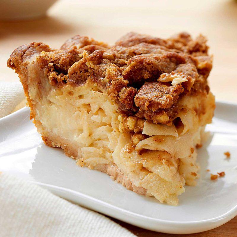 A slice of sour cream apple walnut pie