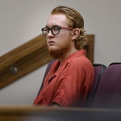 Tyerell Przybycien, 18, of Spanish Fork, waits for an evidence hearing to begin in Provo's 4th District Court on Wednesday, Aug. 23, 2017. Przybycien is charged with murder, a first-degree felony, in the death of 16-year-old Jchandra Brown, who was found hanging from a rope near Maple Lake in Payson on May 6. Prosecutors say Przybycien helped Brown prepare to kill herself, then recorded her for 10 to 11 minutes on a cellphone while she did, never trying to help the girl.