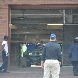 Grounds crew members removing tarps
