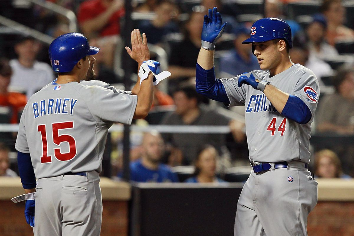 Anthony Rizzo of the Chicago Cubs is greeted by Darwin Barney after hitting a three-run homer against the New York Mets at Citi Field in the Flushing neighborhood of the Queens borough of New York City.  (Photo by Mike Stobe/Getty Images)