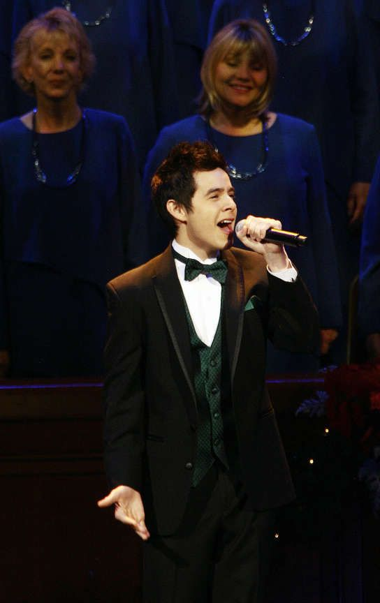 David Archuleta performs with the Mormon Tabernacle Choir during the annual Christmas concert at the Conference Center in Salt Lake City on Friday, Dec. 17, 2010.