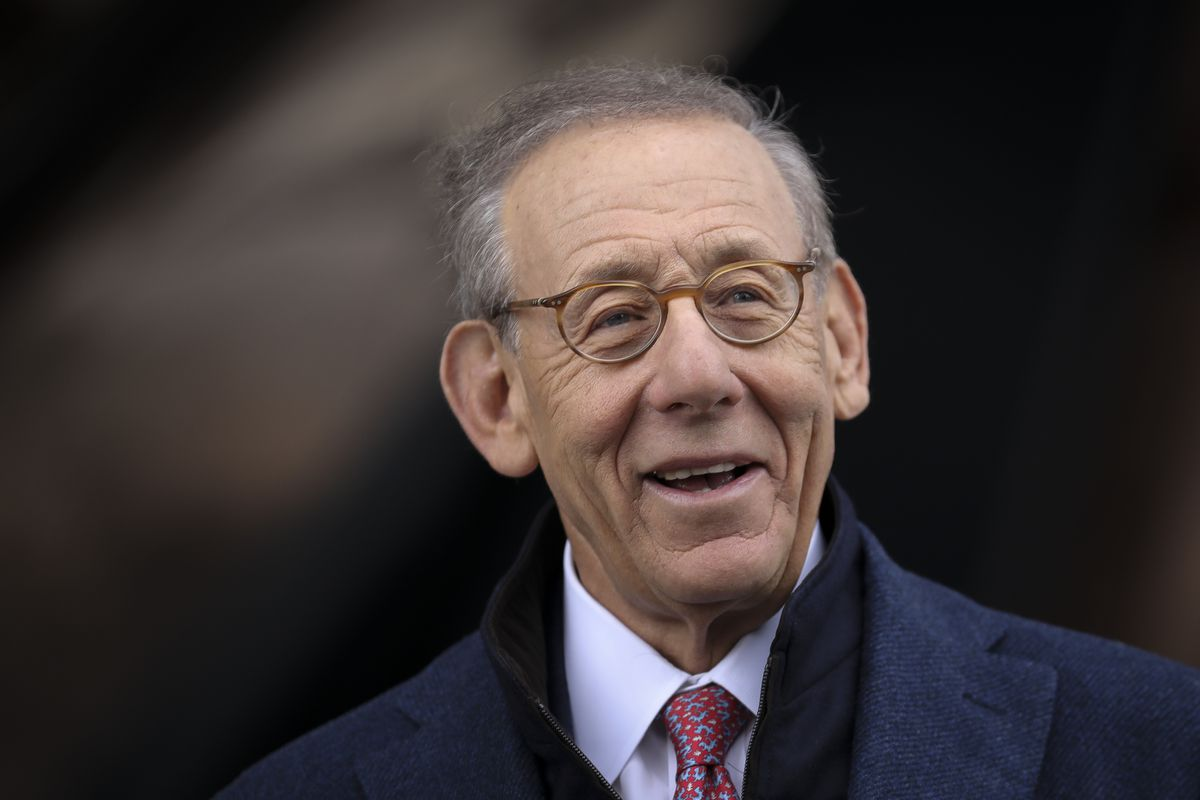 Stephen Ross has gray hair, glasses, and wears a tie.