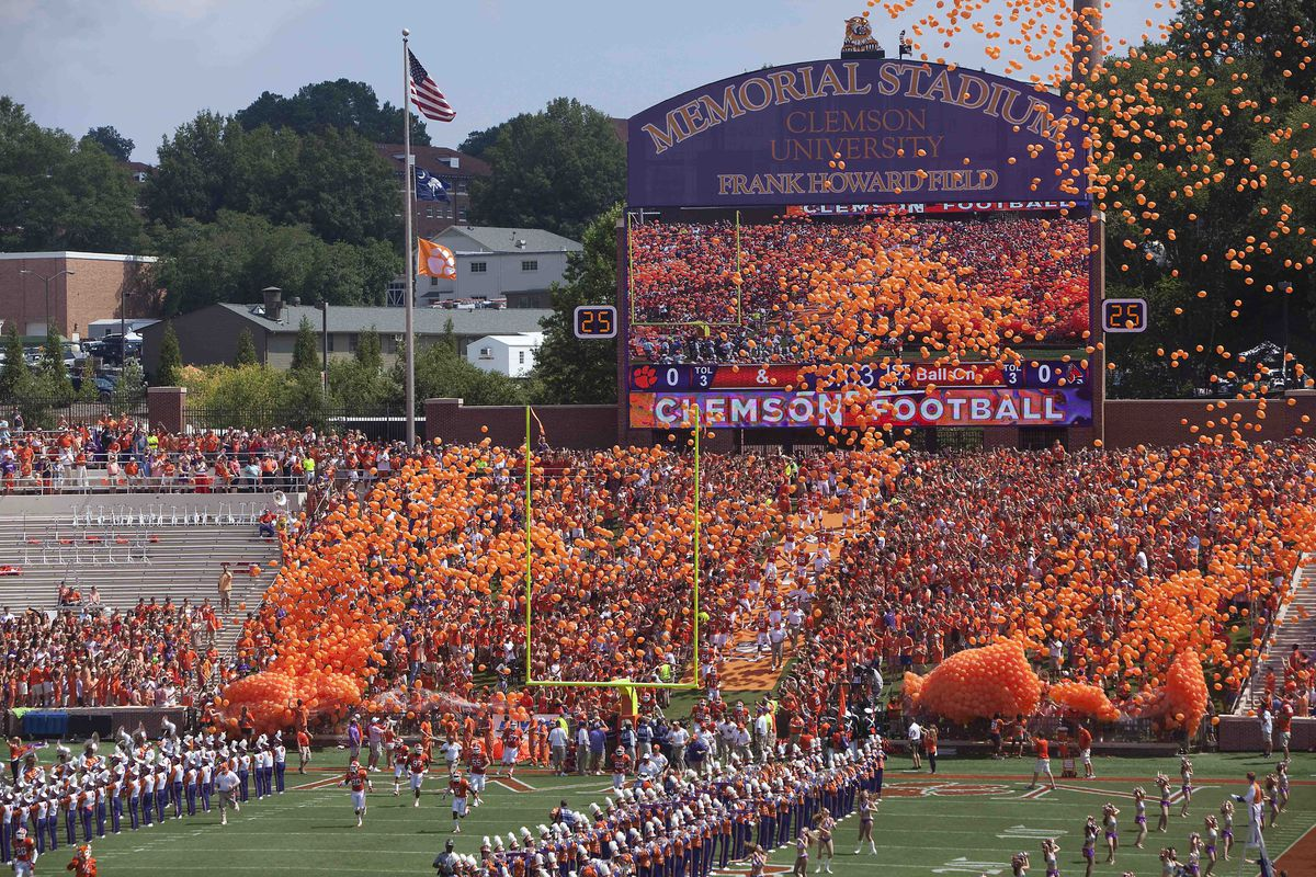 Sep 8, 2012; Clemson, SC, USA; Clemson Tigers players run onto the field prior to the start of the game against the Ball State Cardinals at Memorial Stadium. Clemson won 52-27. Mandatory Credit: Joshua S. Kelly-US PRESSWIRE