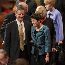 Elder David A. Bednar and his wife Susan Kae exit the stand following the Sunday afternoon session of the 183rd Semiannual General Conference for the Church of Jesus Christ of Latter-day Saints Sunday, Oct. 6, 2013 inside the Conference Center.