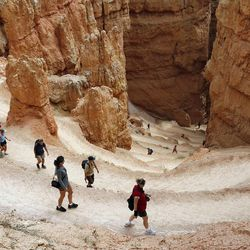 Hikers at Bryce Canyon National Park negotiate Navajo Loop, Sept. 14, 2007. There has been debate on whether recreation areas and national parks in Utah should be opened and run by the state during the federal government shutdown.
