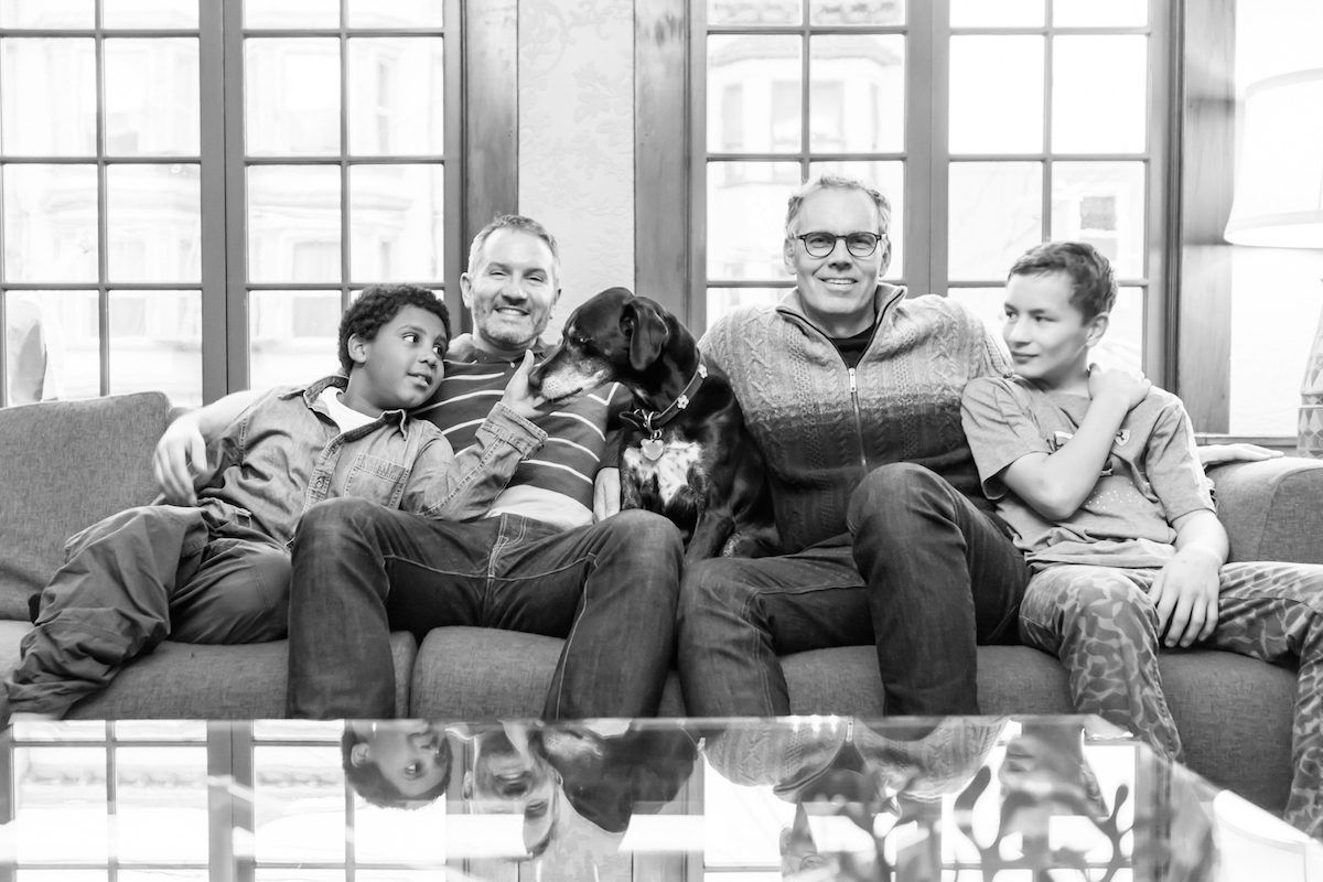 """<span class=""""credit"""">Danny (center left) and Steve with their two sons.</span>"""