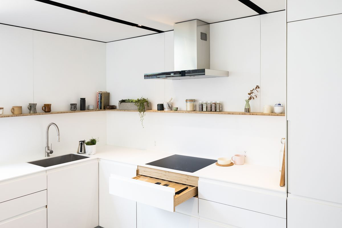 Kitchen with shelves and white cabinets