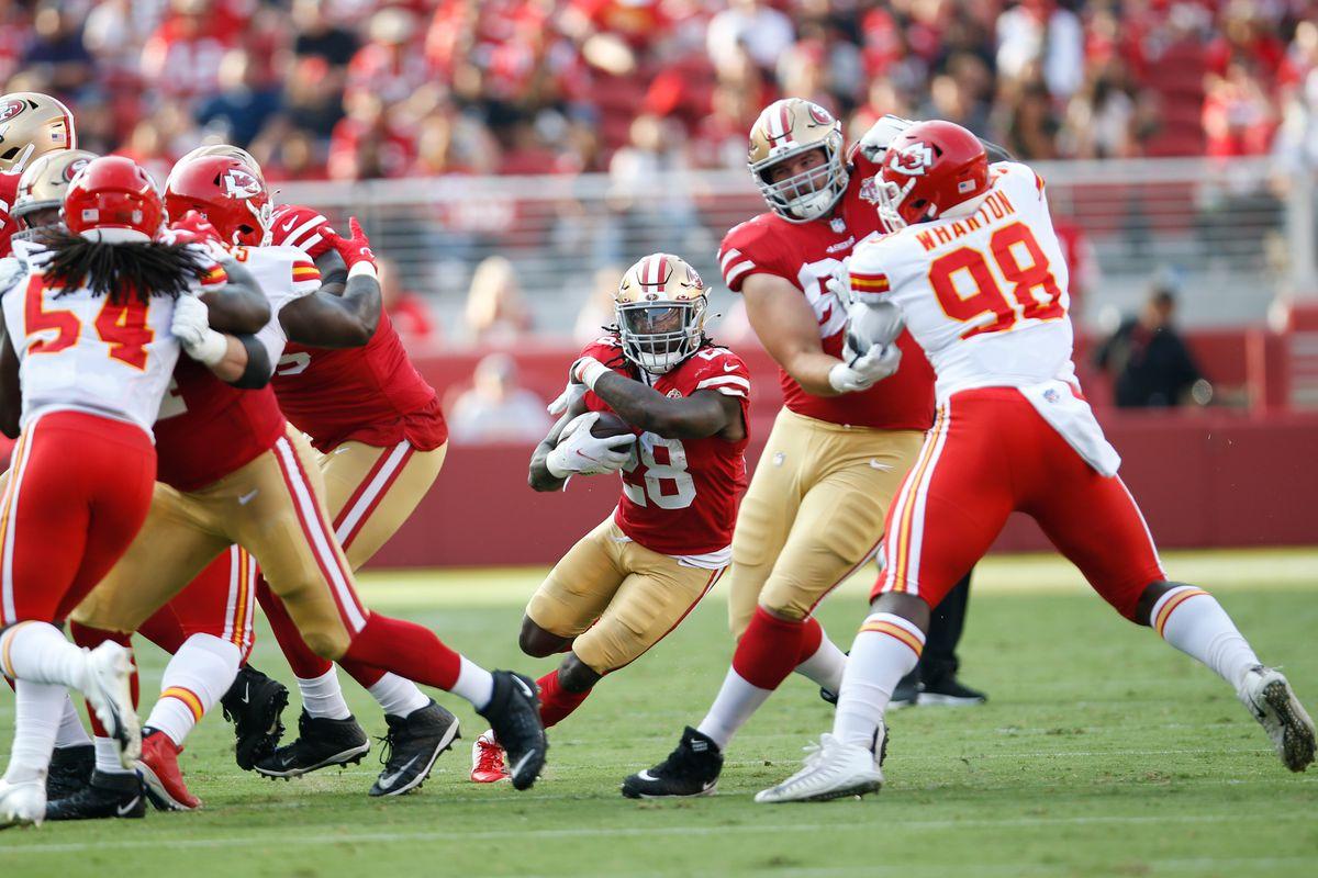 Trey Sermon #28 of the San Francisco 49ers rushes during the preseason game against the Kansas City Chiefs at Levi's Stadium on August 14, 2021 in Santa Clara, California.