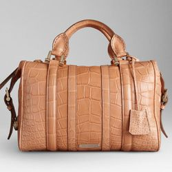 """<b>Burberry</b> Medium Alligator Leather Bowling Bag in pale tan, <a href=""""http://us.burberry.com/store/womens-accessories/bags/exotic-bags/prod-38044171-medium-alligator-leather-bowling-bag/?kid=16faf344-4e50-b069-0a6b-000023871344"""">$20,000</a>"""