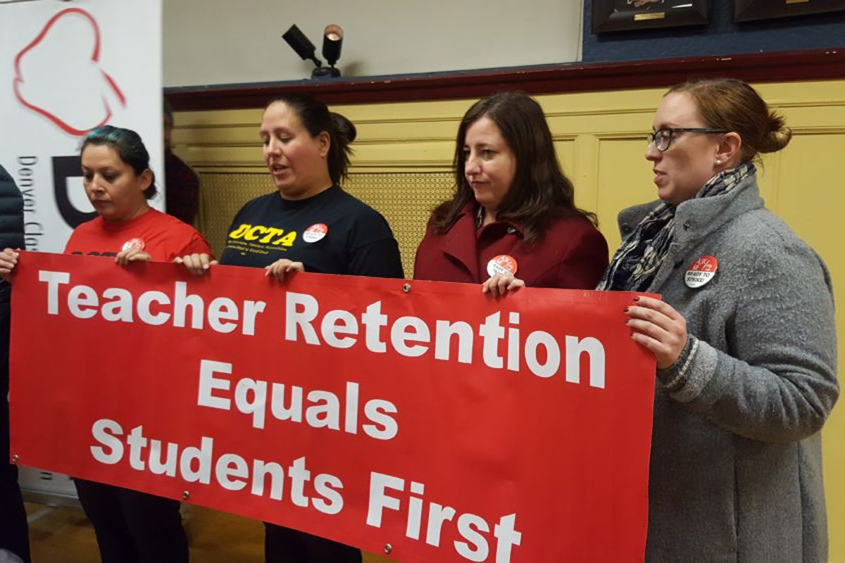 Members of the Denver Classroom Teachers Association announce the results of their strike vote Tuesday.