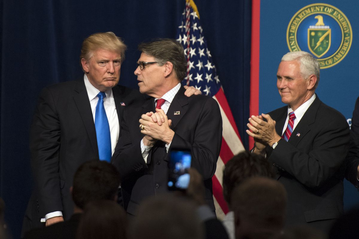 President Donald Trump onstage with Energy Secretary Rick Perry and Vice President Mike Pence.