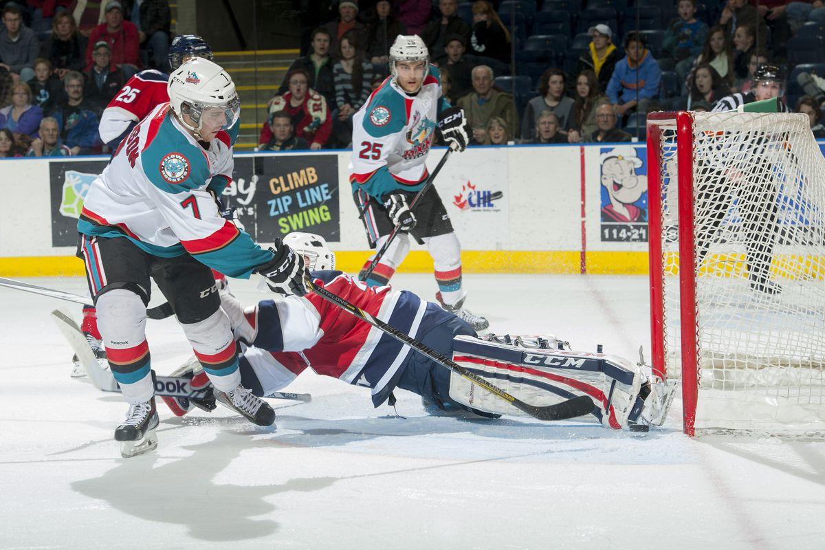 Damon Severson #7 of the Kelowna Rockets scores the seventh goal on Evan Sarthou #31 of the Tri City Americans during the third period on March 8, 2014 at Prospera Place in Kelowna, British Columbia, Canada.