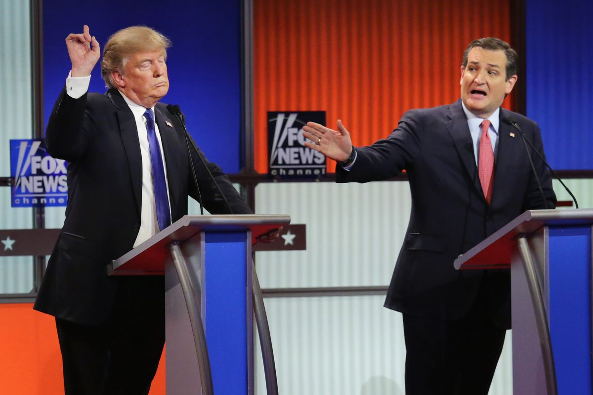 Republican presidential candidates Donald Trump and Sen. Ted Cruz (R-TX) participate in a debate sponsored by Fox News at the Fox Theatre on March 3, 2016, in Detroit, Michigan.