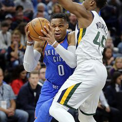 Oklahoma City Thunder guard Russell Westbrook drives to the basket with Utah Jazz guard Donovan Mitchell defending during NBA basketball in Salt Lake City on Saturday, Dec. 23, 2017.