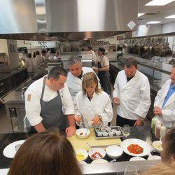 Matt Hurley, left, helps a guest make crab and shrimp Louis.