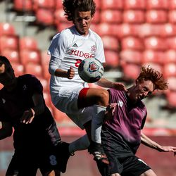 Judge Memorial's Connor Marland jumps between Morgan's Jacob Tolman and Isaac Lowder in the 3A boys soccer championship at Rio Tinto Stadium in Sandy on Tuesday, May 18, 2021.