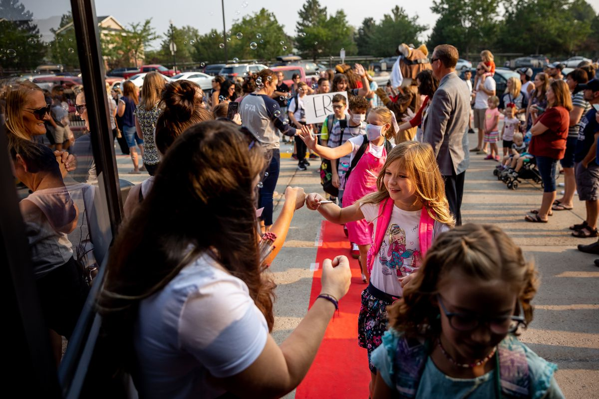 Students are given the red-carpet treatment as they arrive for the first day of school at Altara Elementary in Sandy on Monday, Aug. 16, 2021.