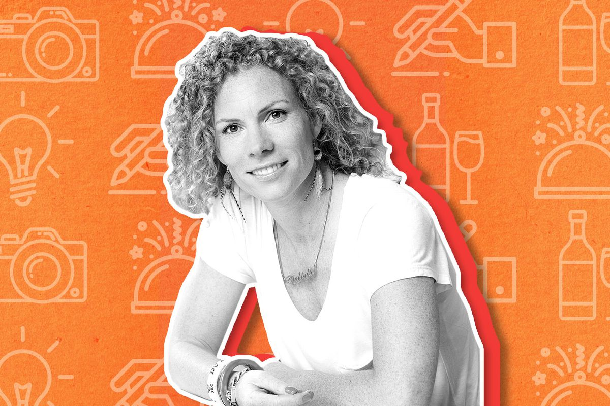 Karen Herold is a white woman with curly blonde hair. She's wearing a white shirt and smiling into the camera in this black and white cutout image that's placed on an orange background.