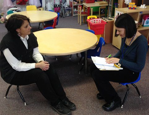 Terri Stowell, right, interviews lead teacher Cristina Maginot about the preschool's schedule, materials and practices during her recent visit.