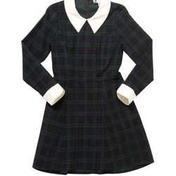 """In God We Trust 'Wednesday' dress, <a href=""""http://ingodwetrustnyc.com/collections/womens/products/black-watch-plaid-wednesday-dress"""">$220</a>"""