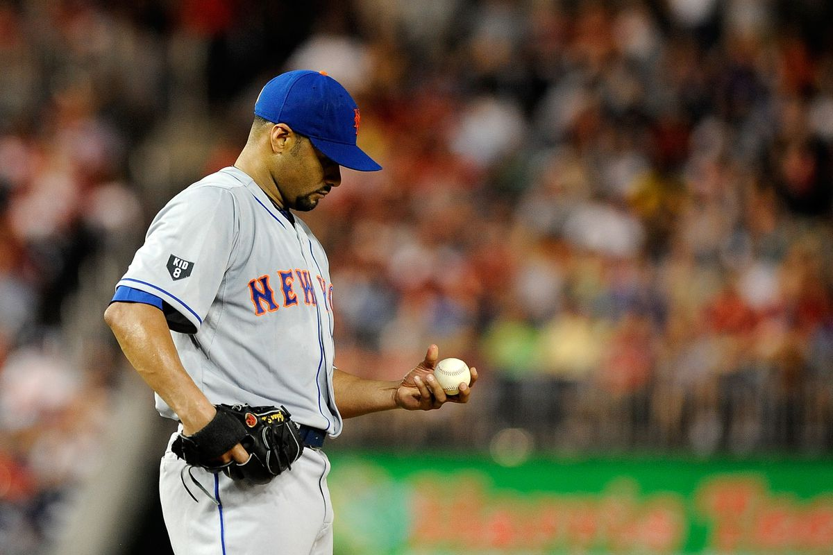WASHINGTON, DC - AUGUST 17: Johan Santana #57 of the New York Mets prepares to throw a pitch against the Washington Nationals at Nationals Park on August 17, 2012 in Washington, DC. (Photo by Patrick McDermott/Getty Images)