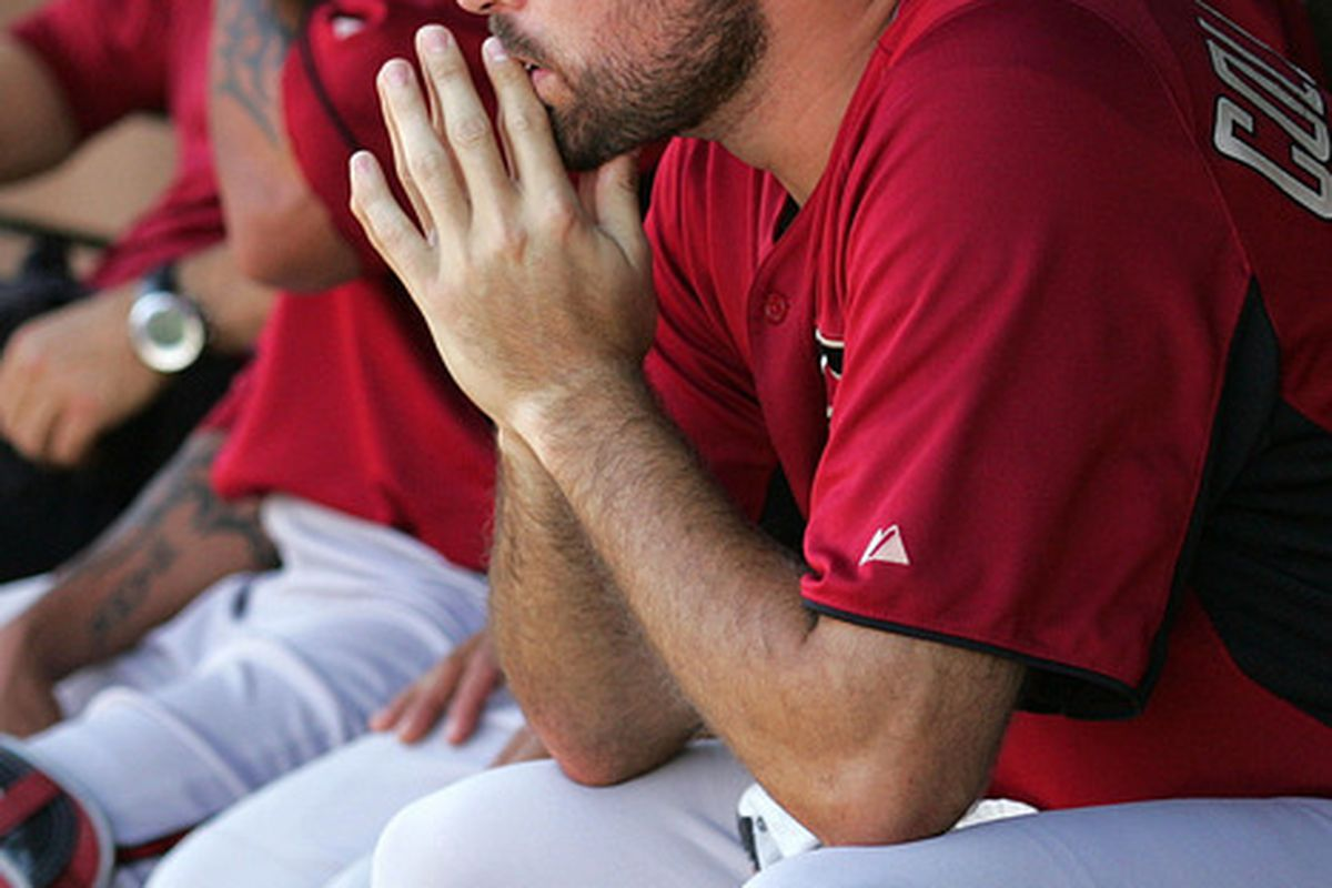 Mar 30, 2012; Tempe, AZ, USA; Arizona Diamondbacks starting pitcher Josh Collmenter (55) in the dugout after the first inning against the Los Angeles Angels at Tempe Diablo Stadium.  Mandatory Credit: Jake Roth-US PRESSWIRE