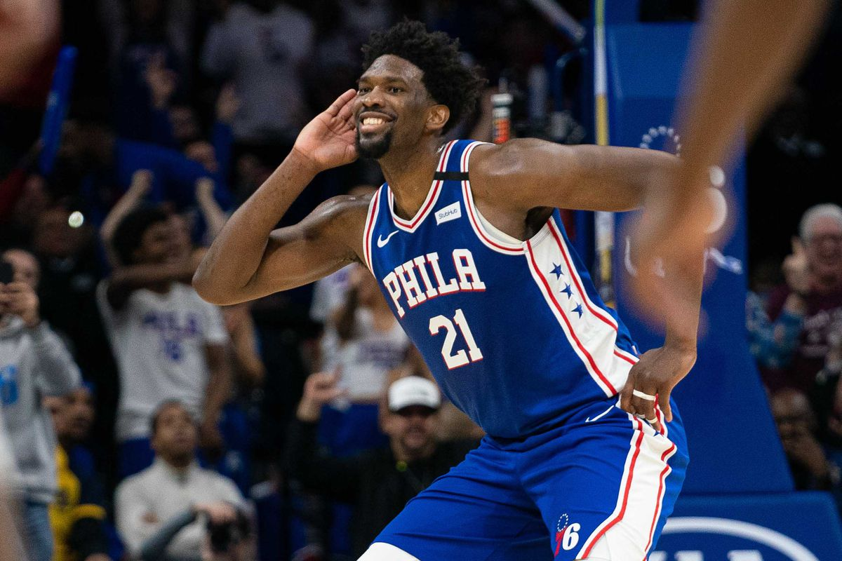 Philadelphia 76ers center Joel Embiid reacts after his three-point score against the Atlanta Hawks during the fourth quarter at Wells Fargo Center.