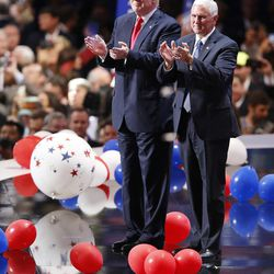 Donald Trump and Mike Pence applaud the attendees during the final night of the National Republican Convention in Cleveland on Thursday, July 21, 2016.
