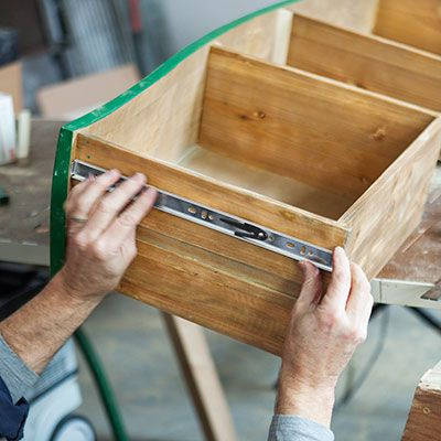 Man Sets Drawer Rail Of Bathroom Vanity Dresser