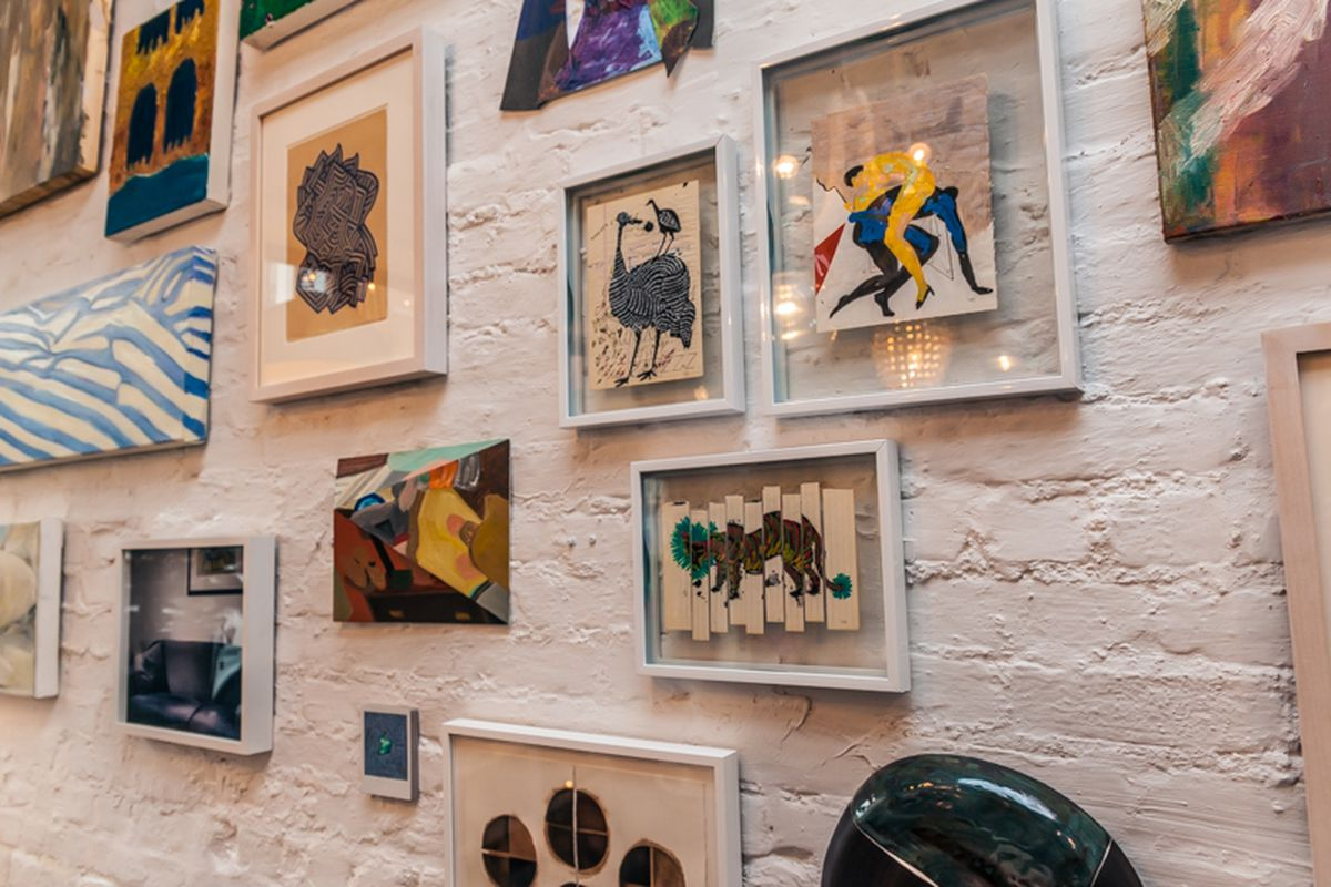 """Art hanging at home goods shop Collyer's Mansion. Photo by <a href=""""http://peladopelado.com"""">Driely S.</a>"""