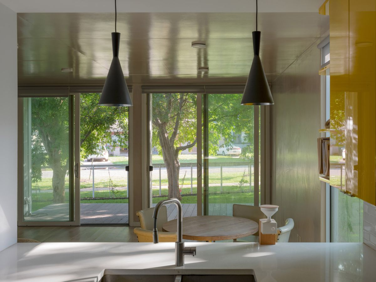 Interior of house with yellow cabinets