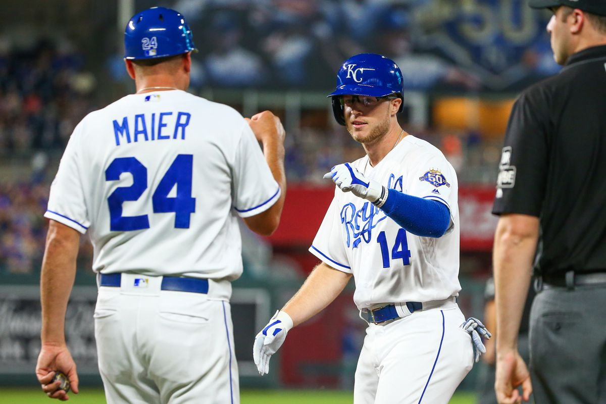 Kansas City Royals right fielder Brett Phillips (14) is congratulated by first base coach Mitch Maier (24) in the game against the Chicago Cubs at Kauffman Stadium.
