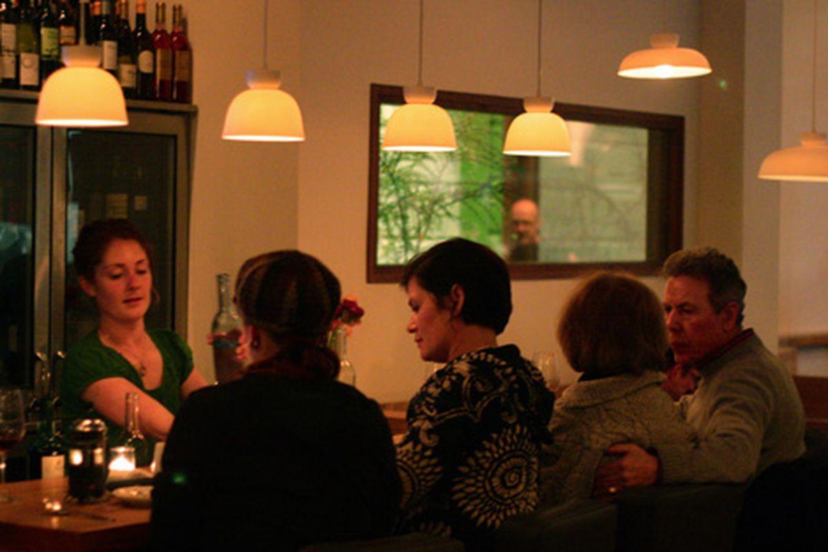 The Contigo wine bar, where Brett Emerson appears in the mirror.