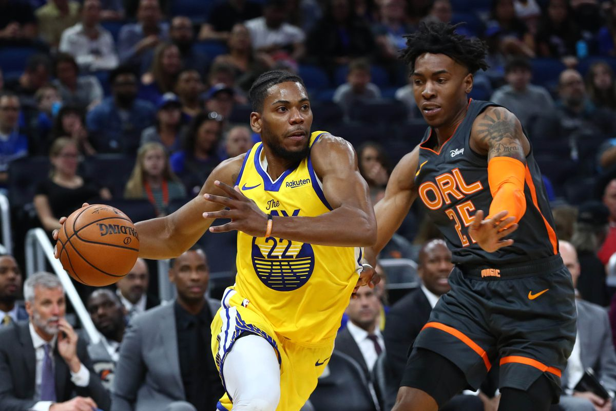 Golden State Warriors forward Glenn Robinson III drives to the basket as Orlando Magic forward Wes Iwundu defends during the first quarter at Amway Center.