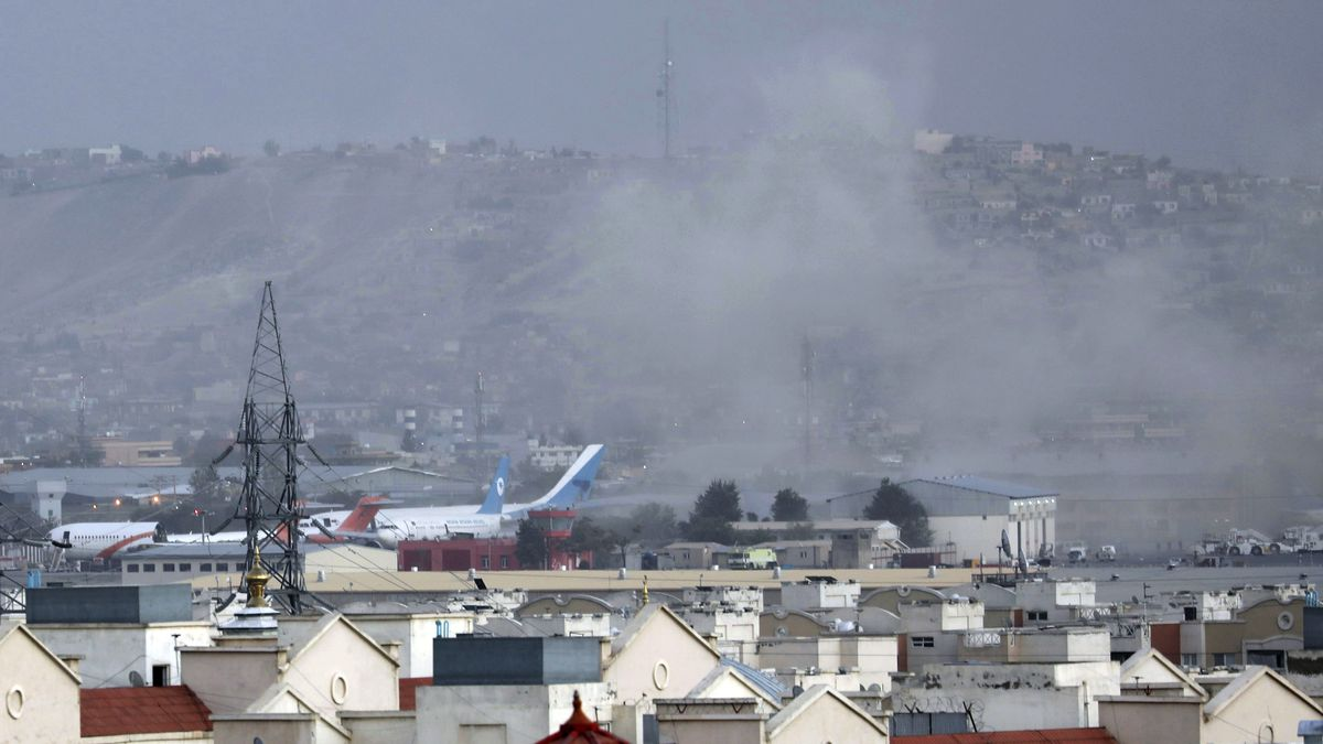 Smoke rises from a deadly explosion outside of  the airport in Kabul, Afghanistan, on Thursday, Aug. 26, 2021.