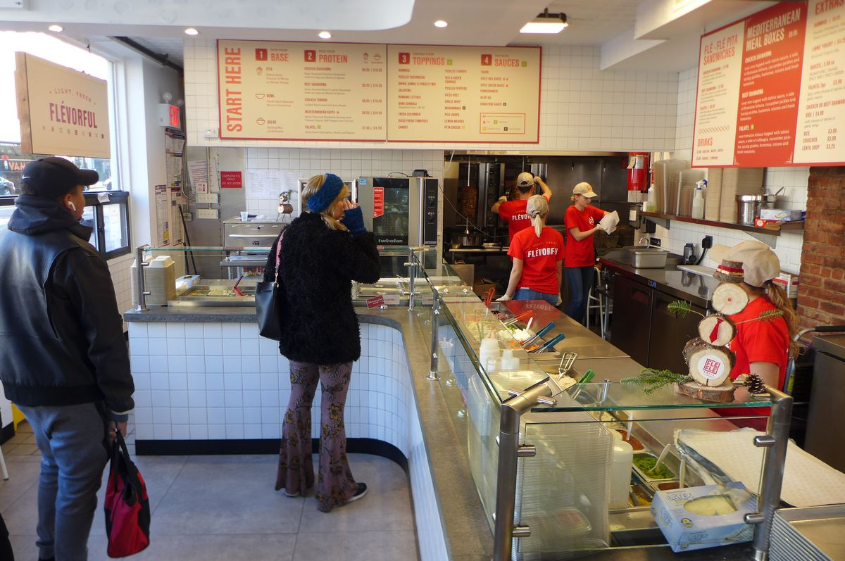 Fle Fle offers bowls, trays, and pita sandwiches.