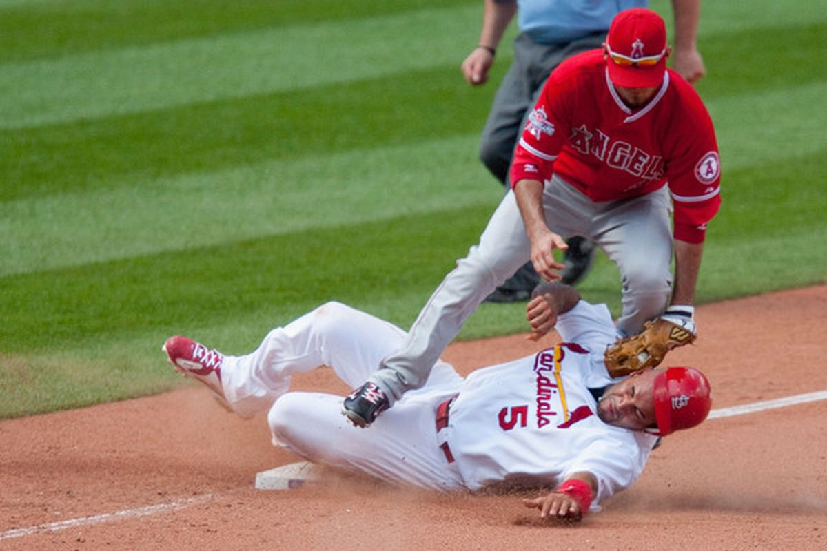 ST. LOUIS - MAY 23: Albert Pujols #5 of the St. Louis Cardinals steals third base against Brandon Wood #3 of the Los Angeles Angels of Anaheim at Busch Stadium on May 23, 2010 in St. Louis, Missouri.  It was awesome.