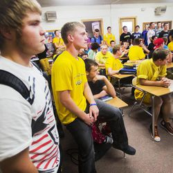 With their jerseys hanging nearby, Union High School football players in Roosevelt attend a meeting Wednesday, Sept. 25, 2013. Nine players were told they wouldn't be playing in Friday's homecoming game. The football coaches at Union High in Roosevelt have taken a stand against poor performance in the classroom and bullying outside the classroom, including disrespect of teachers and students.