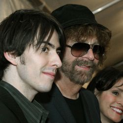 Dhani Harrison, left, the son of late Beatles guitarist George Harrison and musician Jeff Lynne arrive at the 19th Annual Rock and Roll Hall of Fame induction ceremony Monday, March 15, 2004, at New York's Waldorf Astoria. Woman at right is unidentified. (AP Photo/Tina Fineberg)
