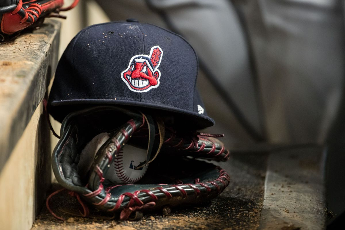 Cleveland Indians baseball hat and glove. Brace Hemmelgarn Getty Images eaa4bdcd23c0