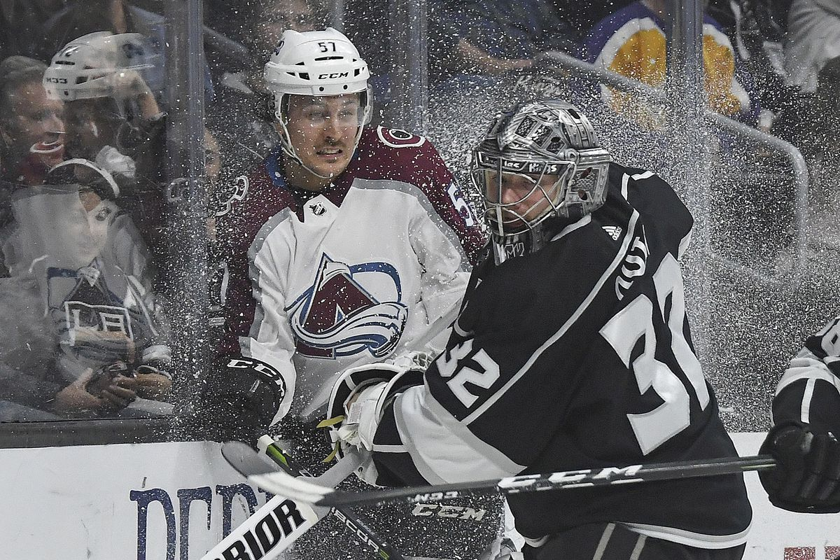 Apr 2, 2018; Los Angeles, CA, USA; Los Angeles Kings goaltender Jonathan Quick (32) checks Colorado Avalanche left wing Gabriel Bourque (57) into the boards in the second period during an NHL hockey game at Staples Center. The Kings defeated the Avalanche