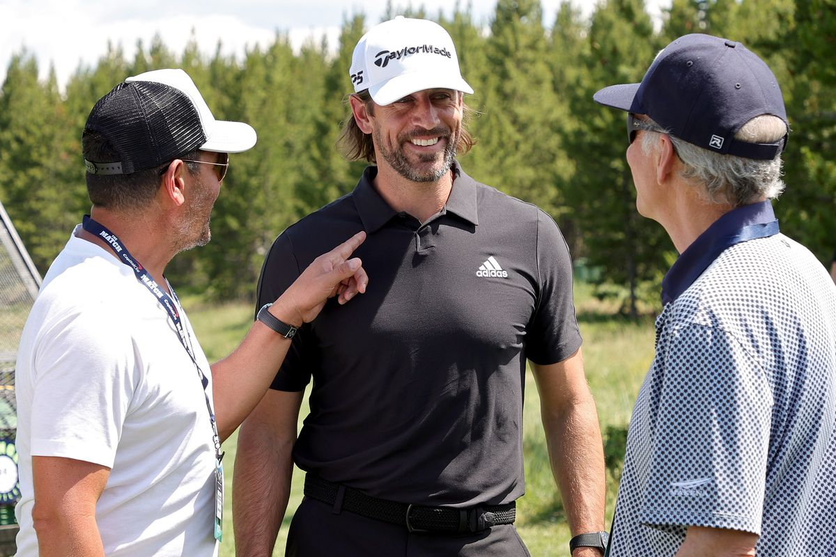Aaron Rodgers (C) meets with guests during Capital One's The Match at The Reserve at Moonlight Basin on July 06, 2021 in Big Sky, Montana.