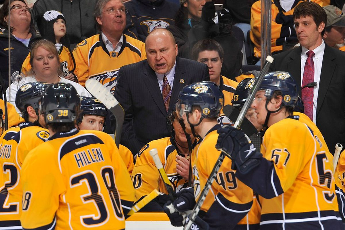 NASHVILLE, TN - JANUARY 01: Head coach Barry Trotz of the Nashville Predators coaches his team against the Calgary Flames at Bridgestone Arena on January 1, 2012 in Nashville, Tennessee. (Photo by Frederick Breedon/Getty Images)
