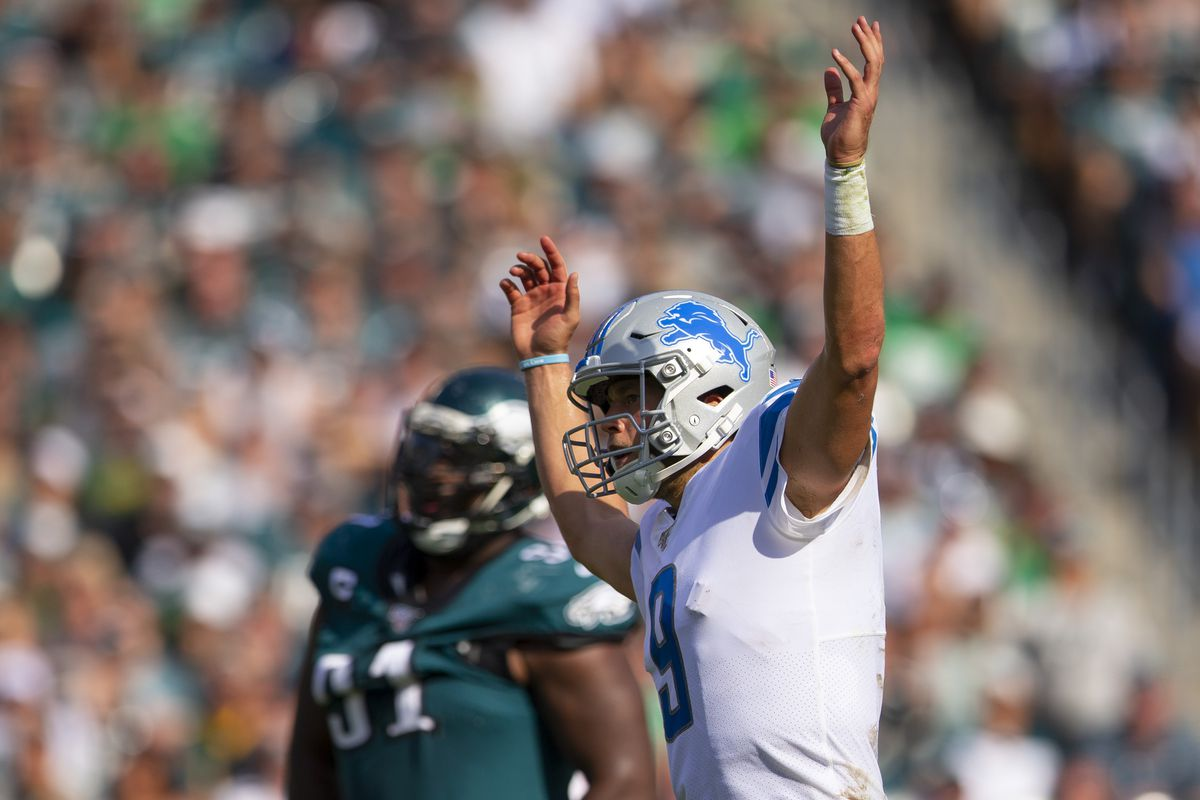 Matthew Stafford of the Detroit Lions reacts in front of Fletcher Cox of the Philadelphia Eagles after throwing a touchdown pass in the fourth quarter at Lincoln Financial Field on September 22, 2019 in Philadelphia, Pennsylvania.