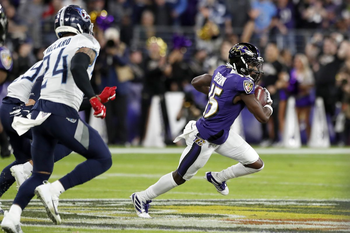 Marquise Brown of the Baltimore Ravens carries the ball against the defense of the Tennessee Titans during the AFC Divisional Playoff game at M&T Bank Stadium on January 11, 2020 in Baltimore, Maryland.