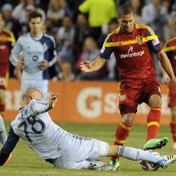 Sporting KC's Aurelien Collin steals the ball from Real Salt Lake's Alvaro Saborio during a game at Sporting Park in Kansas City, Kan., on Saturday, April 5, 2014.