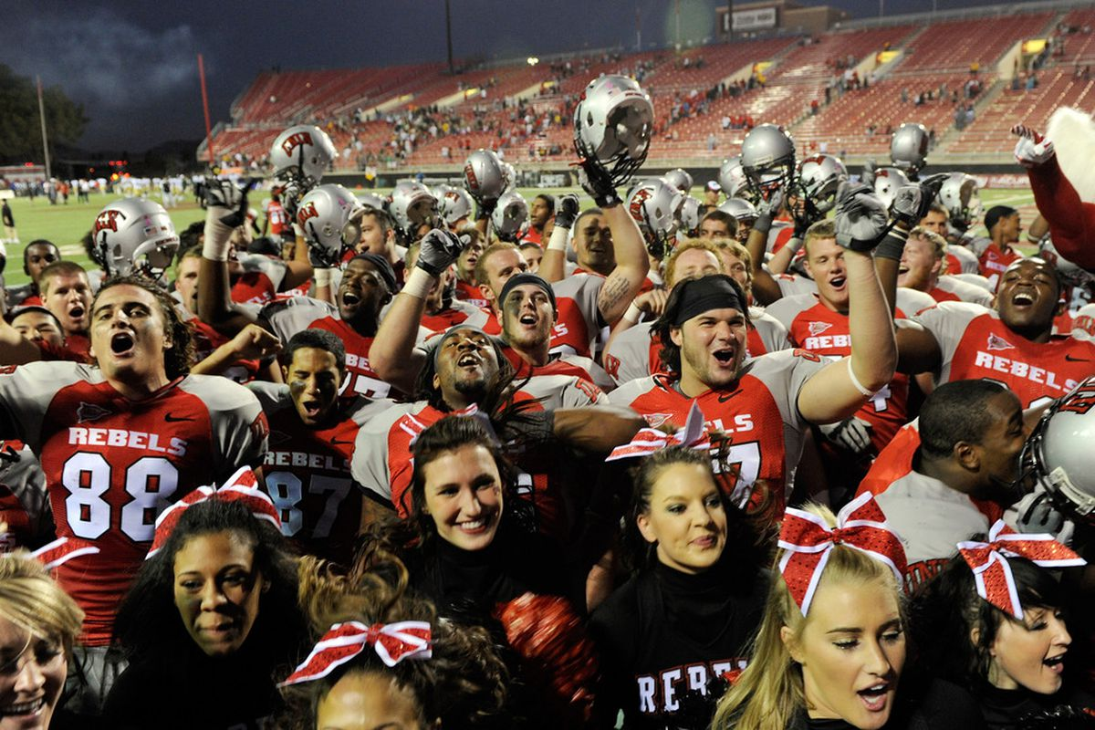 LAS VEGAS, NV - OCTOBER 29:  UNLV Rebels football players and cheerleaders celebrate the team's 38-35 win over the Colorado State Rams at Sam Boyd Stadium October 29, 2011 in Las Vegas, Nevada.  (Photo by Ethan Miller/Getty Images)
