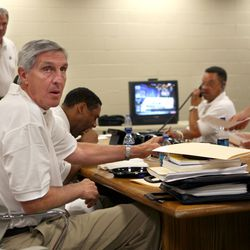 Jazz coach Jerry Sloan and the Jazz staff talk before the 2006 NBA basketball draft at the Delta Center.