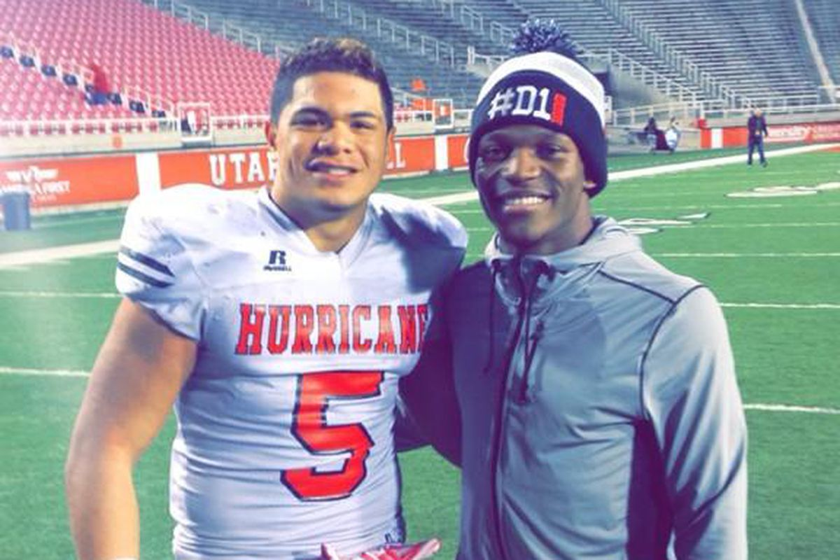 Ieremia (left) and Lake (right) pose for a picture at Rice Eccles Stadium where Ieremia's Hurricane Tigers played in the 3AA state playoffs.