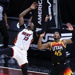 Miami Heat center Bam Adebayo (13) and Utah Jazz guard Donovan Mitchell (45) trey to grab the ball as the Utah Jazz and the Miami Heat play an NBA basketball game at Vivint Smart Home Arena in Salt Lake City on Saturday, Feb. 13, 2021.